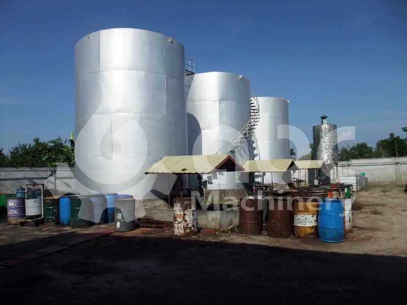 crude coconut oil tanks outside the mill